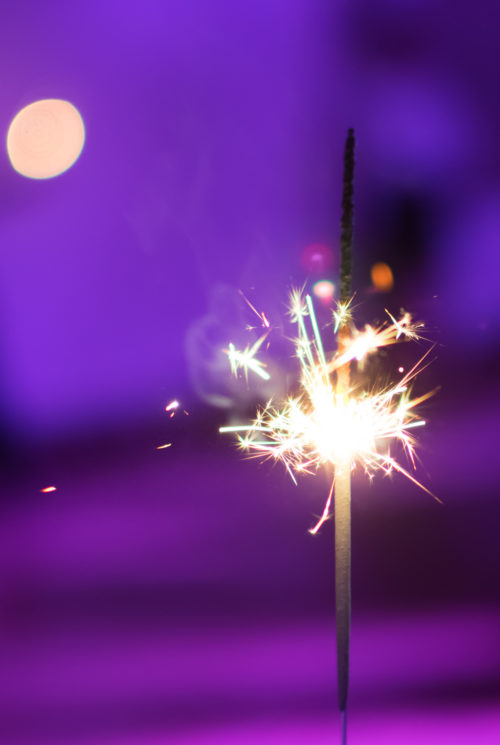 Sparkler against a purple background