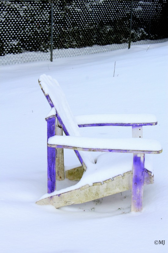 Adirondack chair in the snow