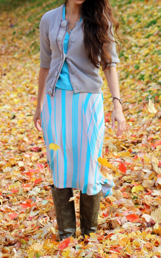 Blue short sleeved sweater + gray cardigan + blue and gray striped skirt and taupe boots