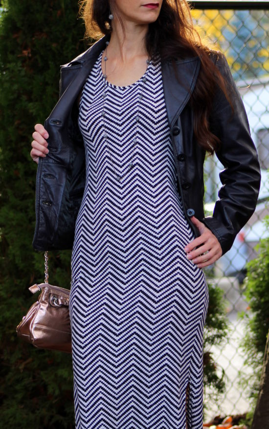 Black leather jacket, black and white zig zag dress + rose gold purse