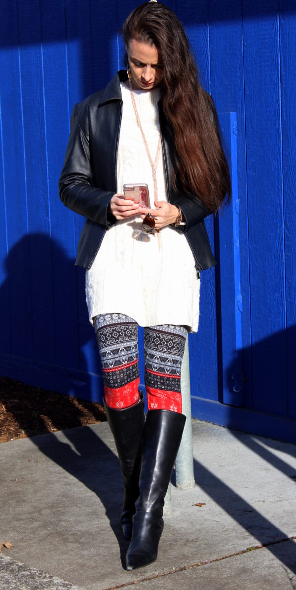 White sweater dress + patterned leggings, black jacket, knee high boots, tassel necklace and fringe earrings