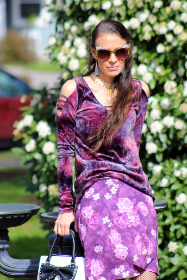 Crushed velvet top, purple floral skirt, red booties, bow tie purse + cat ear sunglasses