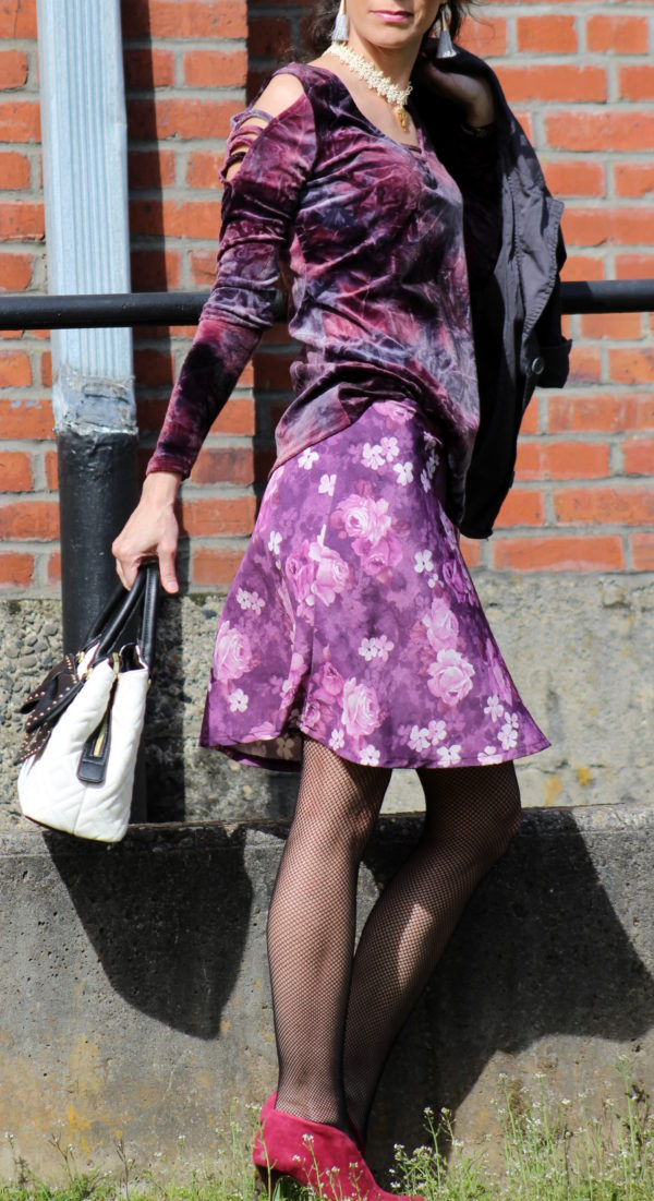 Crushed velvet top, gray jacket, purple floral skirt, red booties, bow tie purse + cat ear sunglasses