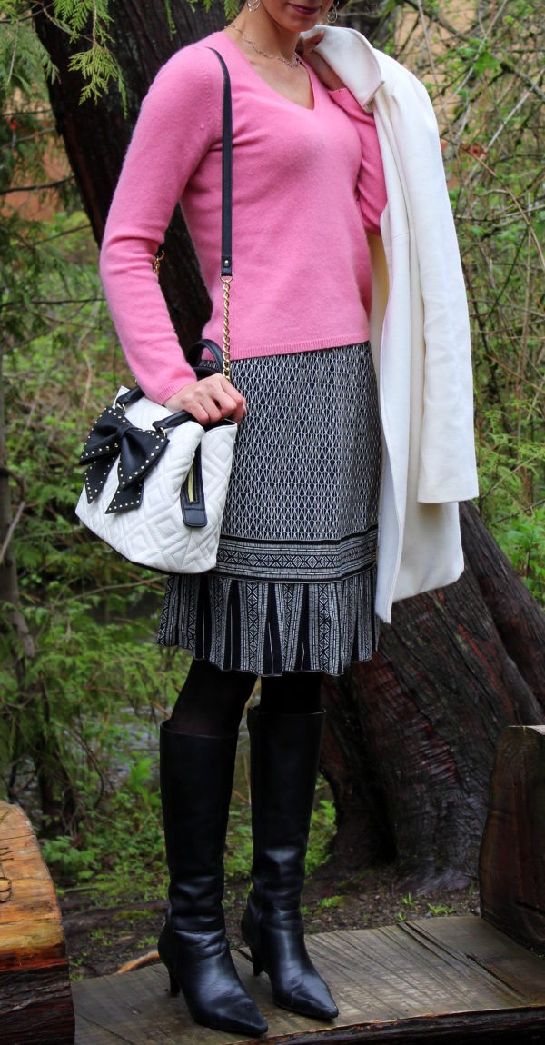 Pink sweater, black and white skirt, Betsey Johnson bow purse, ivory coat + knee high black boots