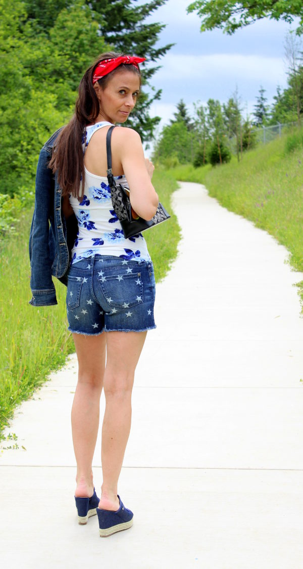 Denim jacket, China blue and white floral tank top, star shorts, blue denim wedge tassel peep toe sandals, Gucci purse, feather earrings + red bandana
