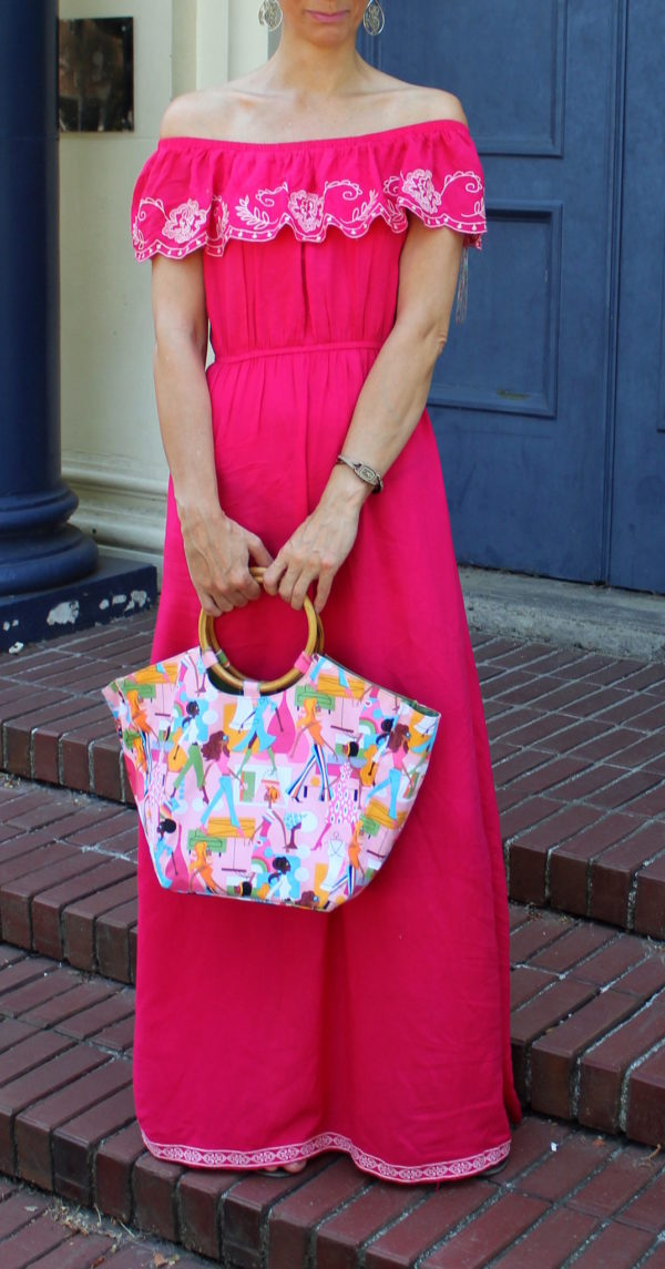 Pink embroidered ruffled maxi dress + Neiman Marcus handbag