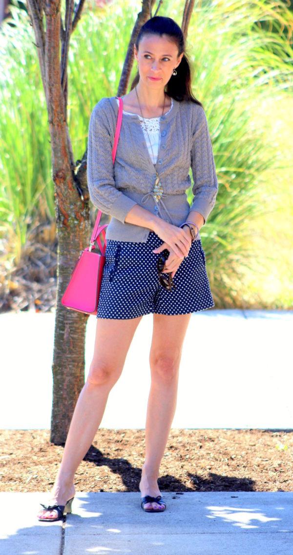 Gray sprakle button up sweater, white cross back short sleeve top, polka dot shorts + Kate Spade handbag