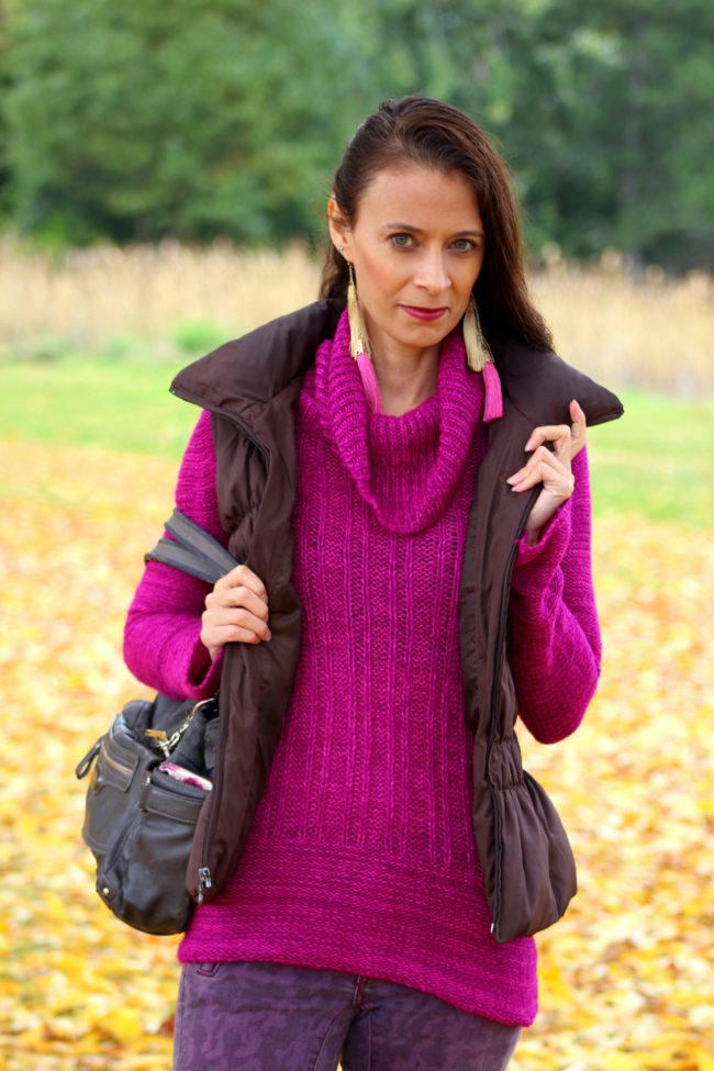Berry pink sweater, purple skinny jeans, brown puffer vest, purple cuff socks, bronze handbag, pink and gold tassel earrings + taupe combat boots #falloutfit