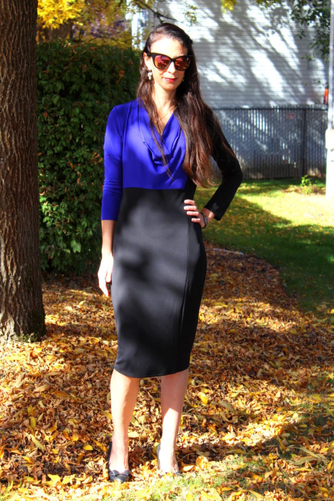 Purple and black colorblock dress + large black cat eye sunglasses and bow tie heels