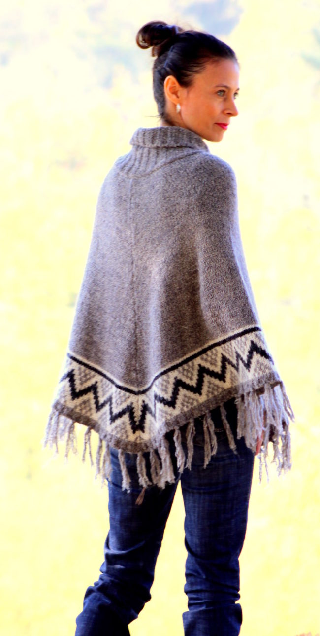 Gray, white and black poncho, jeans, gray bow boots