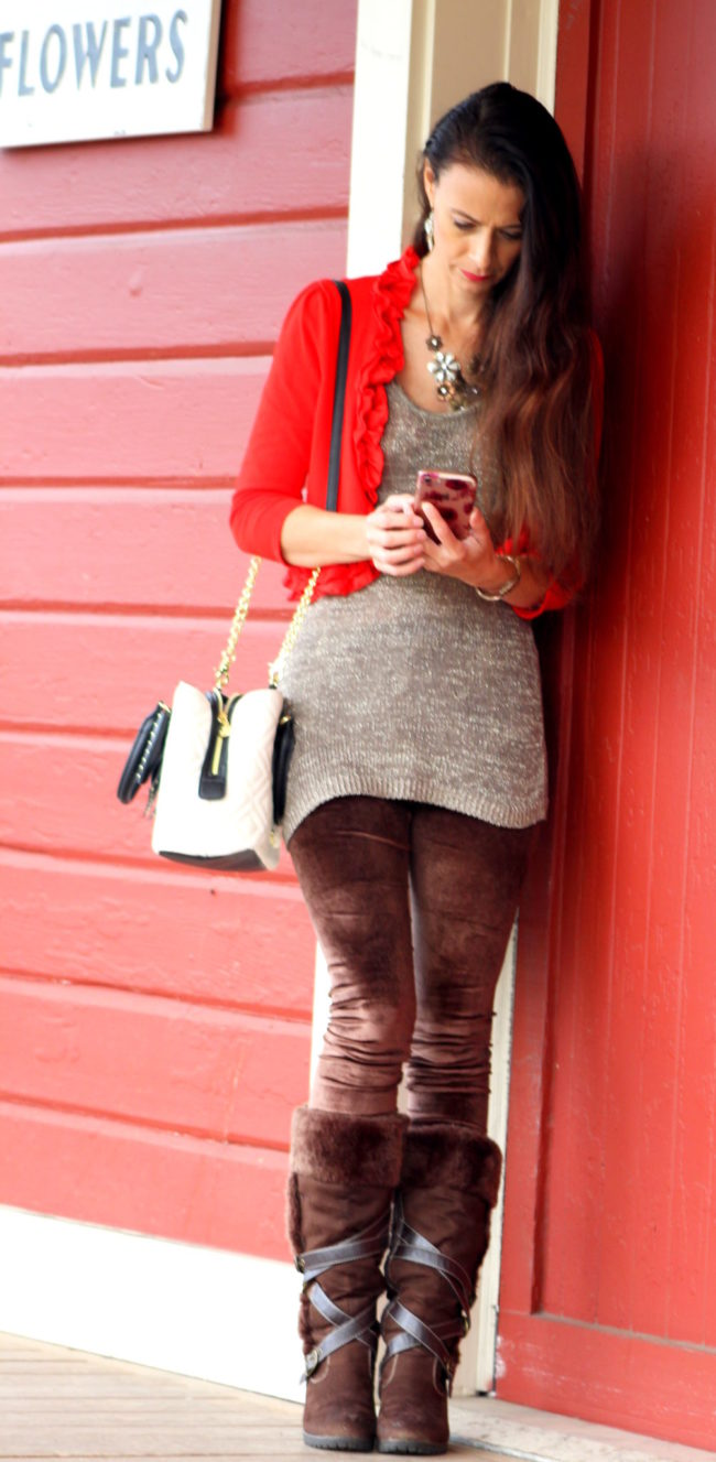 Red ruffled cropped cardigan, sparkle tank top, brown leggings, brown fur lined boots, black and white Betsey Johnson purse + silver feather earrings