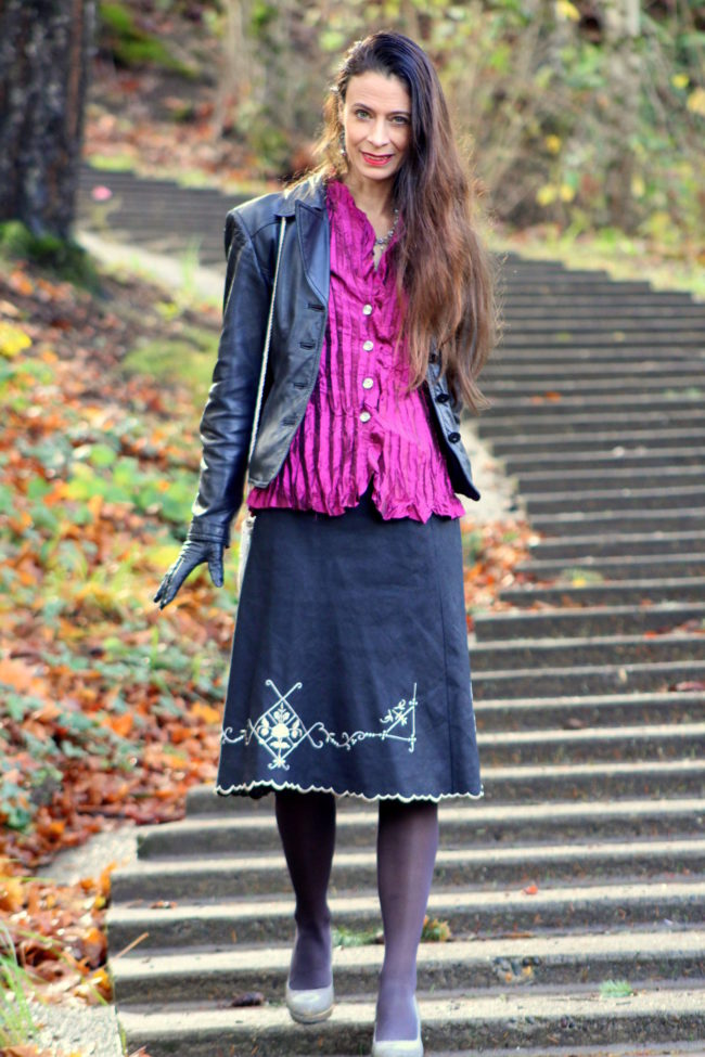 Fuchsia pleated top, black scalloped edge skirt, metallic heels + leather jacket and black gloves