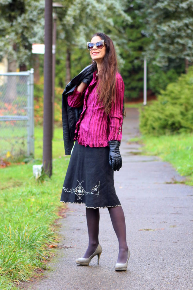Fuchsia pleated top, black scalloped edge skirt, metallic heels + leather jacket, sequined purse, cat ear sunglasses and black gloves