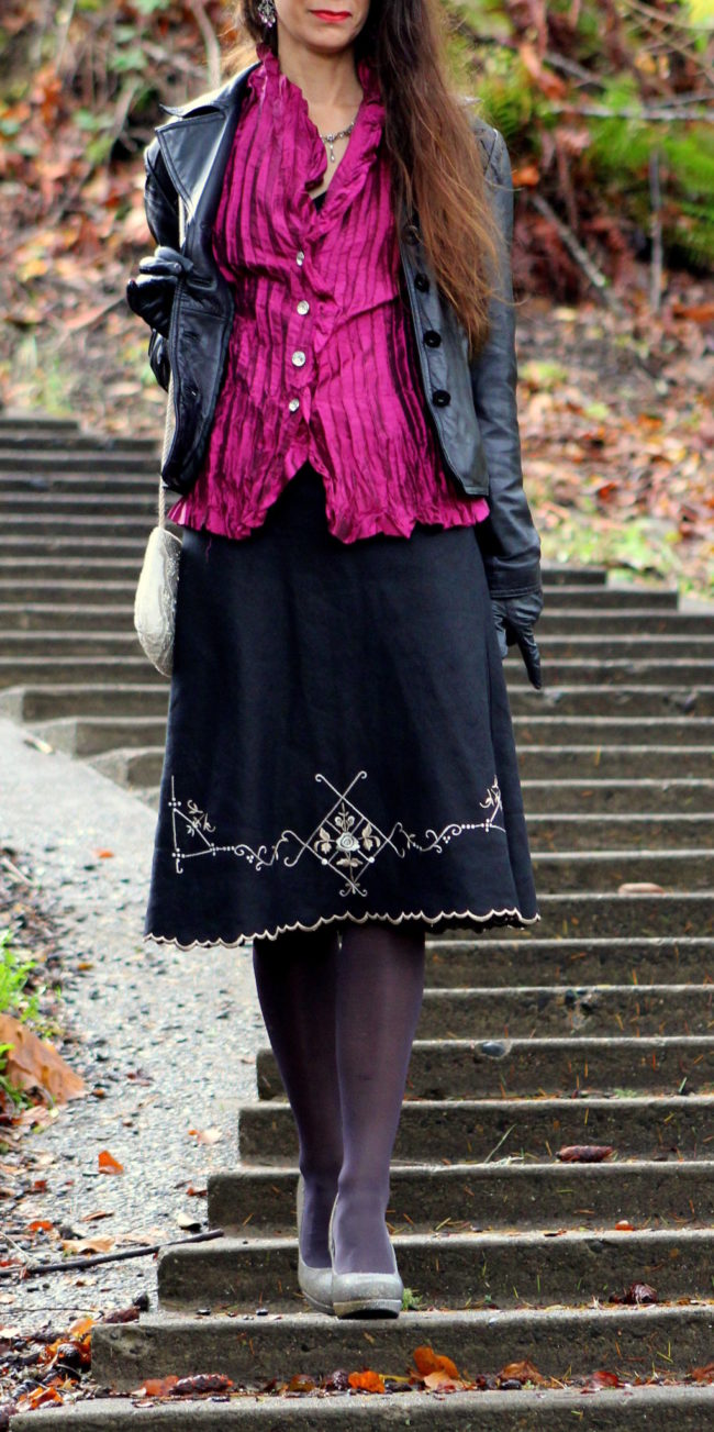 Fuchsia pleated top, black scalloped edge skirt, metallic heels + leather jacket, sequined purse and black gloves