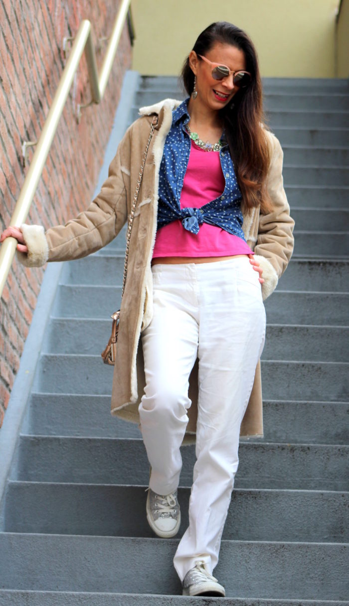 Faux fur trimmed winter coat, chambray heart button up top, pink tee, white pants, rose gold purse & sunglasses + sparkle converse