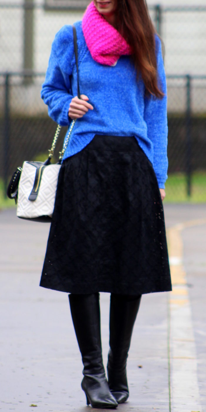 Navy coat, blue sweater, black eyelet lace skirt, pink infinity scarf, Betsey Johnson handbag + black knee high boots