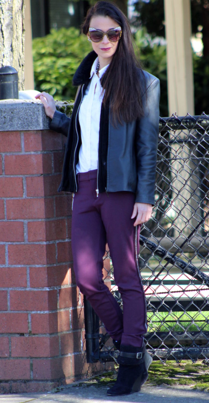 Burgundy pants, white button up shirt, black faux fur collar cardigan, black booties and cat eye sunglasses