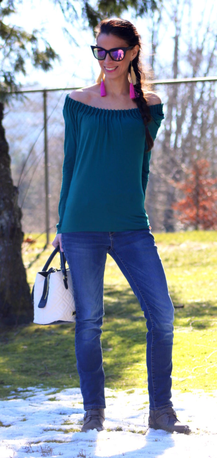 Green top, jeans, gray combat boots, black cat eye sunglasses, Betsey Johnson handbag & tassel earrings