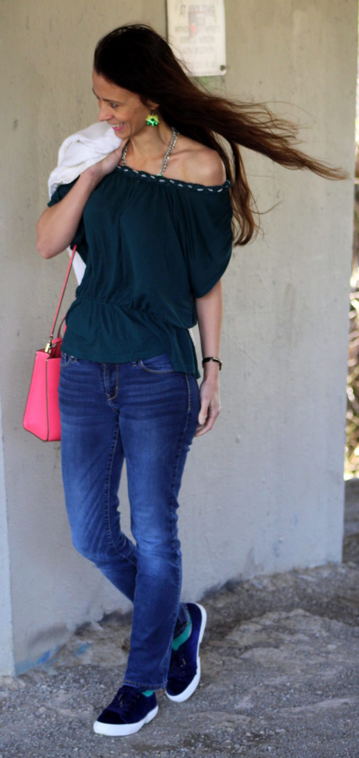 Green off shoulder top, white zip up sweater + jeans & pink Kate Spade New York handbag