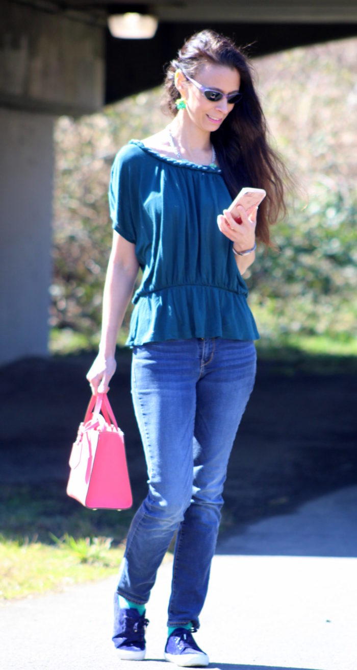 Green off shoulder top + jeans, blue velvet sneakers & pink Kate Spade New York handbag