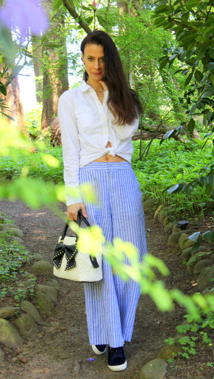 White top + striped pants & Betsey Johnson handbag